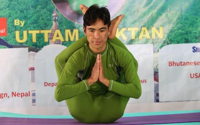 (151218) -- KATHMANDU, Dec. 18, 2015 (Xinhua) -- Nepal's 30-year-old Uttam Moktan performs yoga to challenge the Guinness World Record of the longest yoga marathon, in Kathmandu, Nepal, Dec. 17, 2015. (Xinhua/Sunil Sharma)